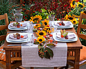 Autumn table decoration with sunflowers and chestnuts