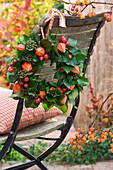 Lanterns, rose hips and ivy wreath