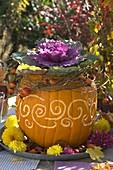 Cucurbita (edible pumpkin) with ornaments as a planter