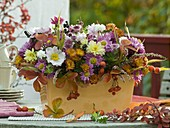 Autumn arrangement in ceramic jardiniere