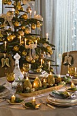 Advent arrangement in elongated gold bowl as table decoration