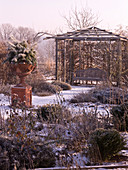 Winter rose garden with wood pavilion