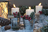 White candles in metal bucket