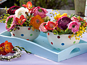 Colorful bouquets in cereal bowls