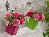 Small bouquets made of dianthus (carnation) and pittosporum