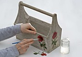 Roses in wooden carrier with napkin technique