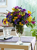 Fragrance bouquet of Freesia (Freesia) in yellow, blue and purple