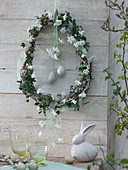 White Easter wreath in egg shape