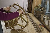 Wicker basket braided in spherical shape