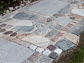 Path paved with natural stones