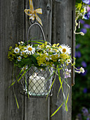 Lantern with wreath of wildflowers