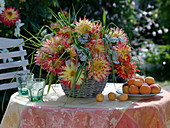 Yellow-red Dahlia, Achillea, grasses in basket vase