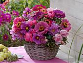 Pink late summer bouquet in basket vase