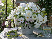 White late summer bouquet made with roses, sweet peas, zinnias