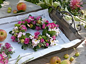 Small late-summer wreath with ornamental apples and florets