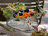 Upside down wire basket for drying flowers and herbs
