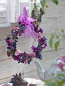 Dried flower wreath hung on drawer knob