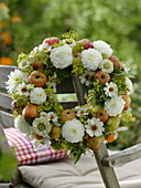 Late summer wreath with white dahlias and apples