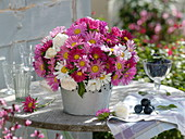 Late summer bouquet of summer asters and roses