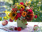 Red-orange late summer bouquet with sunflowers