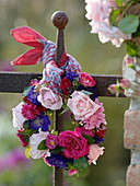 Roses and summer asters wreath on the fence