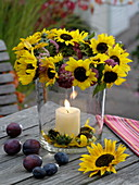 Glass lanterns with wreath of sunflowers and stonecrop