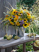 Fragrant sunflowers and asters bouquet in tin tubs
