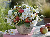 White late summer bouquet with apples and daisies