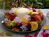 Mobile wreath on tin plate with white candle