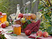 Wire basket with apples, apple jelly and apple juice