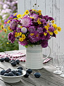 Lilac-yellow late summer bouquet in jug