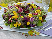 Autumn wreath of chrysanthemums and clematis