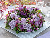 Autumn wreath with violet Rose, aster, hedera