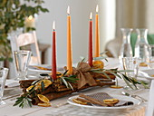 Unusual Advent arrangement of cinnamon sticks