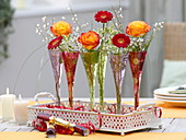 New Year's table decoration with roses and gerberas