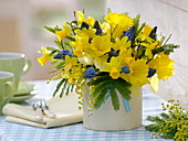 Spring bouquet from Narcissus 'Dutch Master' 'Tete a Tete', Acacia