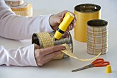 Tin cans with ribbon in yellow and orange spiced up