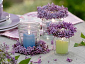 Lantern from screw cap jars with candles and Syringa wreaths