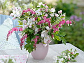 Delicate spring bouquet with Dicentra and Malus 'Evereste'