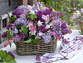 Lilac, columbine and bleeding heart in the basket
