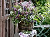 Meadow bouquet in basket vase