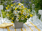 Yellow-white early summer bouquet with daisies