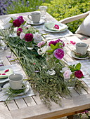 Table decoration of roses and elderberry