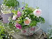 Scented and medicinal herbs bouquet in rose cup