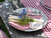 Table decoration with asparagus, radishes and borage