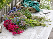 Blue-pink bouquet made of perennials and herbs