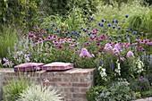 Perennial flowerbed behind brick wall