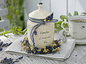 Ceramic tin with camomile and lavender tea, decorated with flowers and wreath