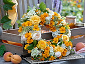 White-yellow late-summer wreath from Tagetes, Clematis