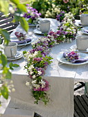 Late summer table decoration with blossom garland